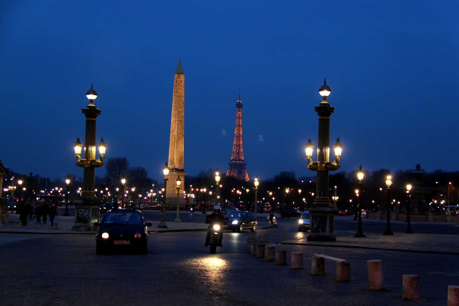 The Luxor Obelisque (Obelisk) in Paris with the Eiffel Tower