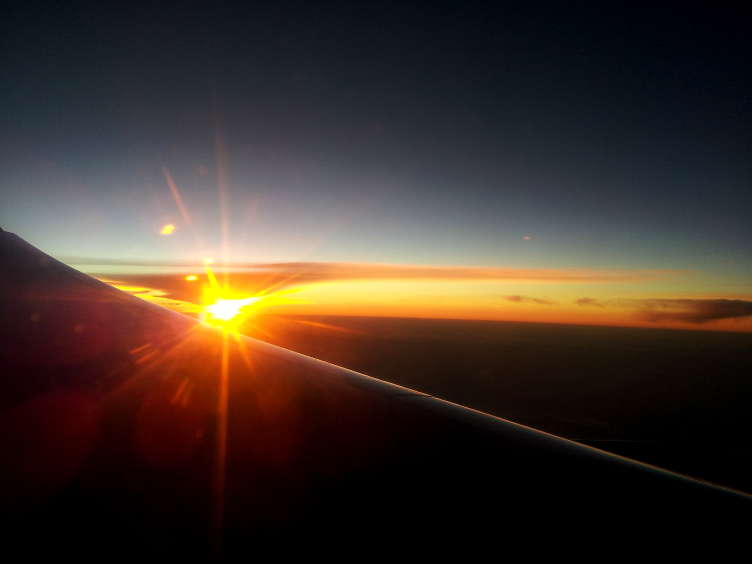 Sunrise seen from the airplane; trip to  Johannesburg