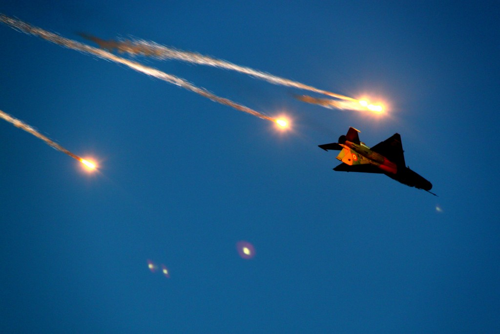 "MiG 21 ""Lancer"" releasing flares during a roll - BIAS 2015"