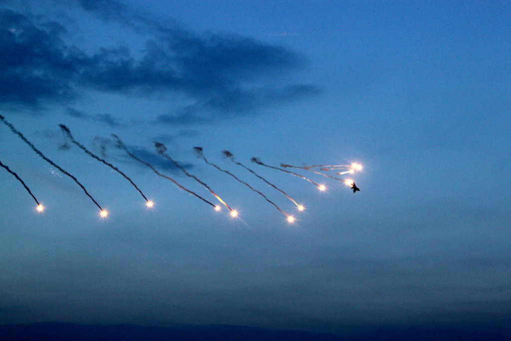 "MiG 21 ""Lancer"" releasing flares during a roll- BIAS 2015"