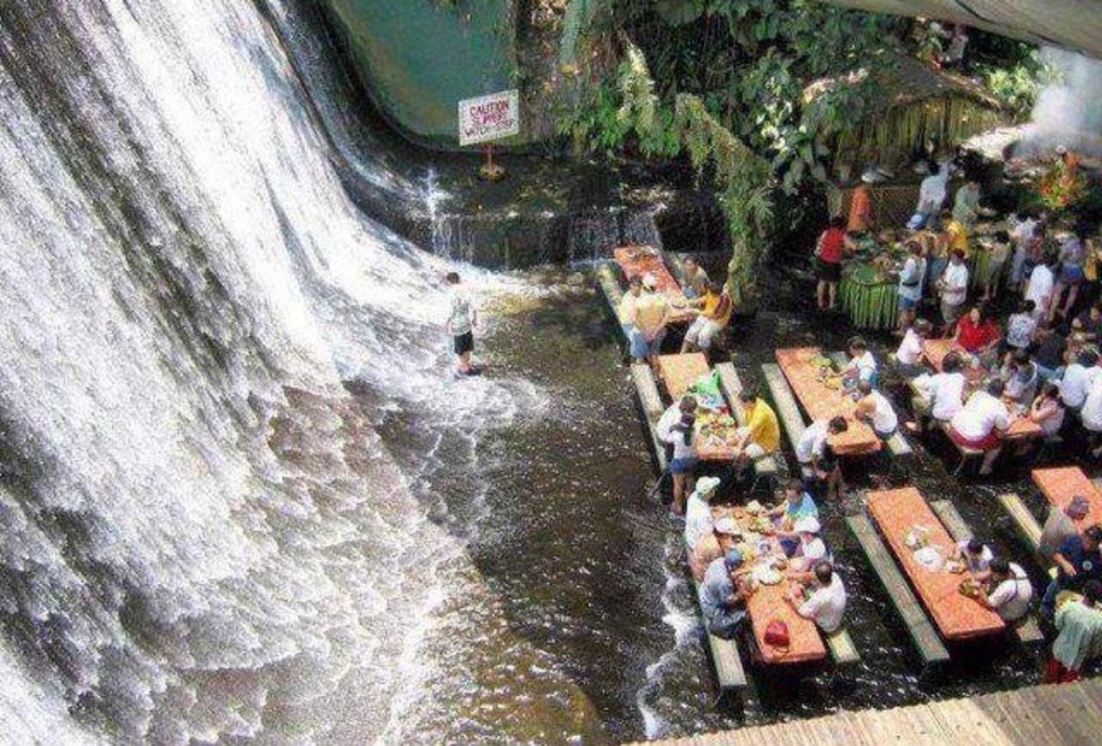 Unique: eat a restaurant at the base of a waterfall in the Philippines