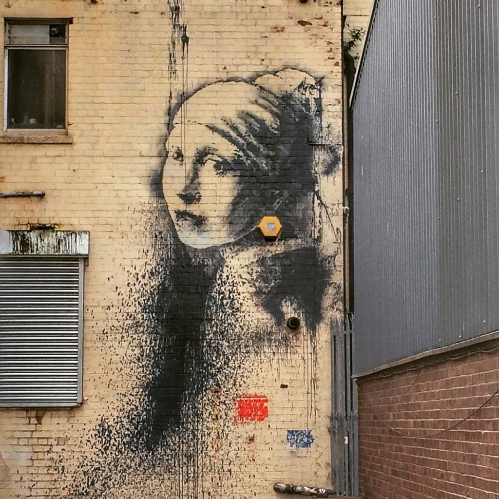 Bristol- Banksy artwork. Read this insider's guide to learn the top attractions in Bristol, England, food in Bristol, and accommodation in Bristol. #bristol #england #uk #bristoltraveling #travelbuide #bristolguide