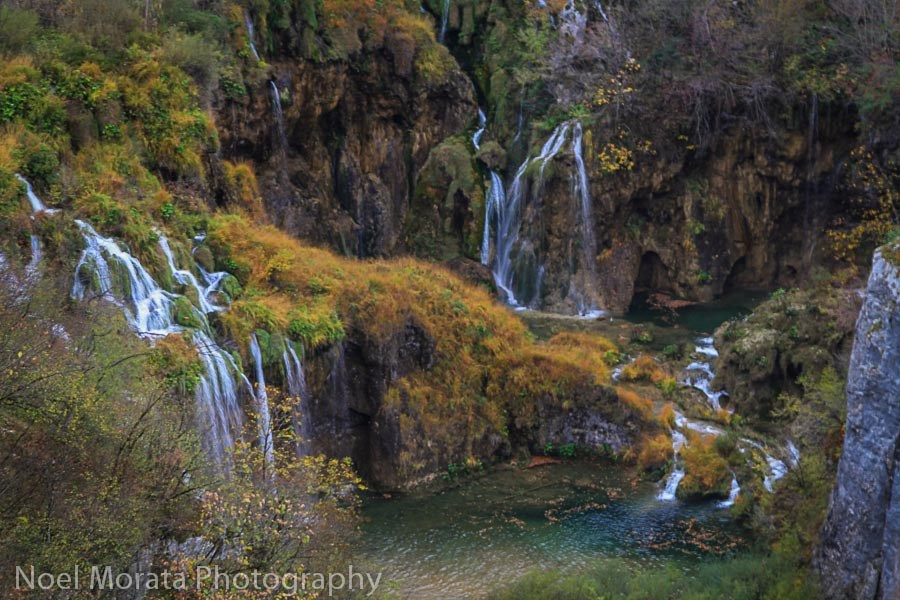 Plitvice National Park in Croatia is one of the best places to visit in Europe in autumn if you want to admire the stunning fall foliage in Europe. Read this article to see Europe's best places for fall travel. #Europe #fall #fallfoliage #foliage #europefoliage #fallcolors #fallcolours #colours#autumn #croatia