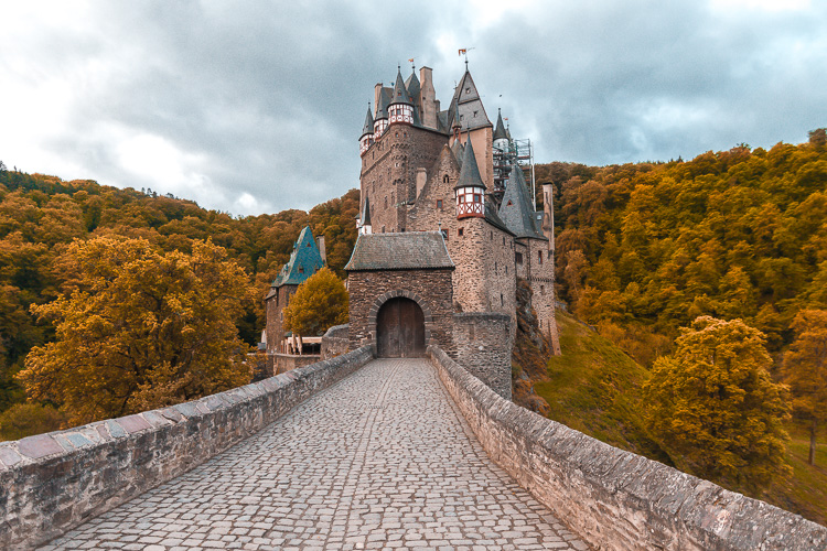 Burg Eltz in Germany is one of the best places to see fall foliage in Europe. Read this article to see Europe's best places for fall travel. #Europe #fall #fallfoliage #foliage #europefoliage #fallcolors #fallcolours #colours#autumn #germany