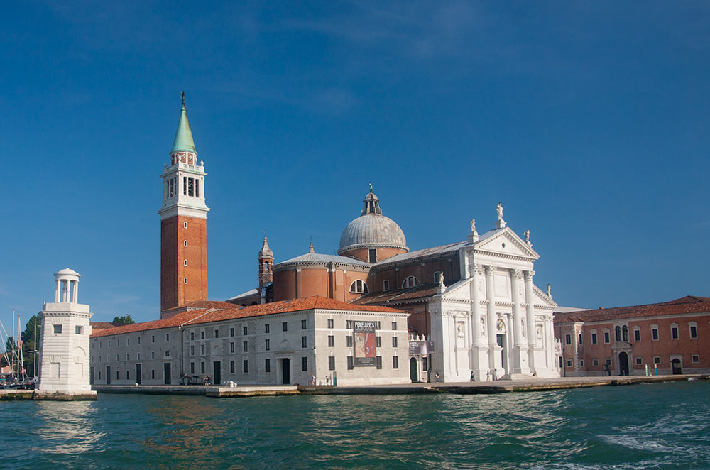 Andrea Palladio's Basilica of San Giorgio Maggiore is one of the most famous sights in Venice, Italy. Read this guide to Venice and discover the top places to visit in Venice, Italy, where to stay in Venice, Venice food, and Venice tips. #venice #veniceguide #venicetravelguide #veniceattractions #venicethingstodo #travel #italy #venicetips #europe