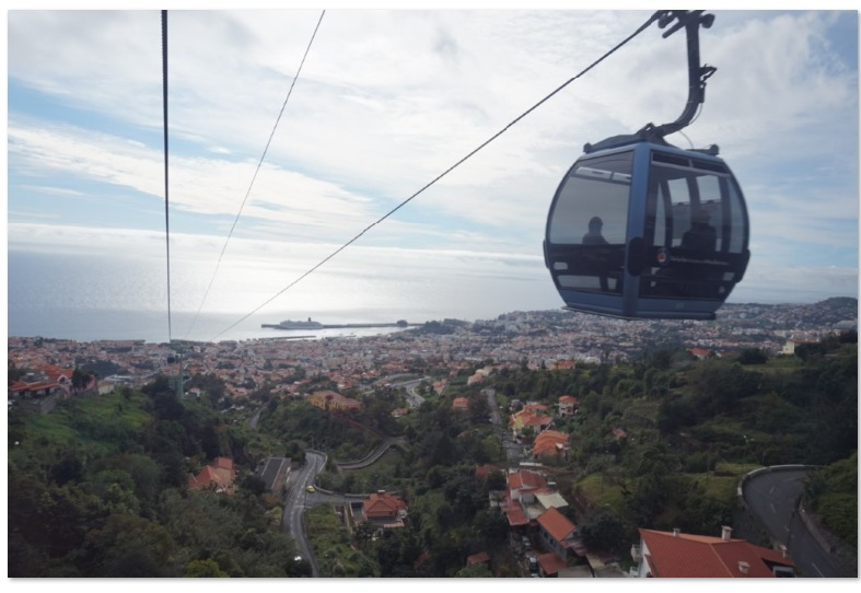 Funchal Cable Car and views on Funchal, Madeira, Spain. Read this ultimate Funchal guide and discover the best things to do in Gunchal, what to eat in Funchal, and tips for visiting Funchal. #funchal #funchalguide #funchalmadeiraguide #funchalmadeira #funchalportugal #funchaltravelguide #funchaltraveling #funchaltips #funchalfood