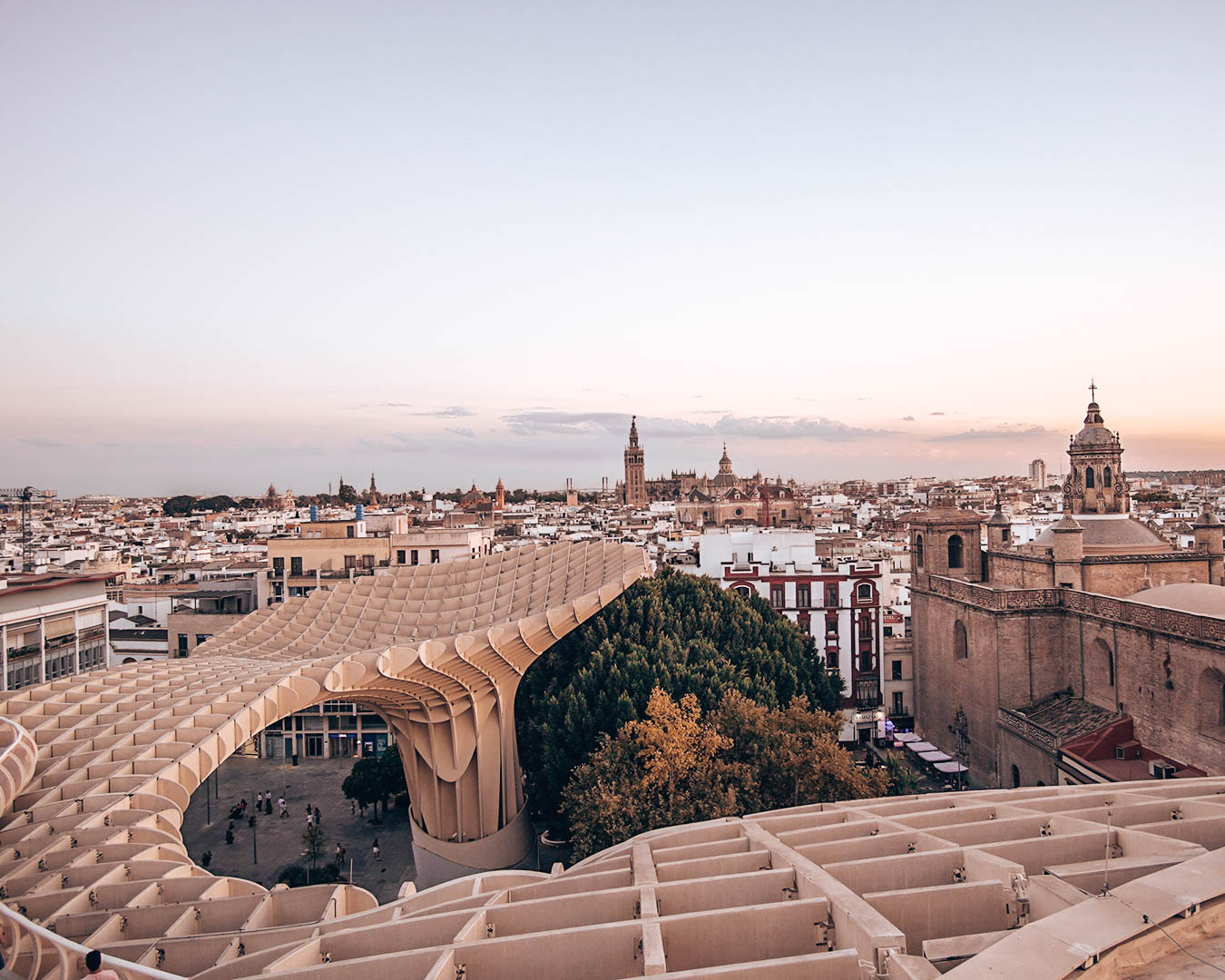 Sunset Views of Seville from the Metropol Parasol. Discover the best places to visit in Seville, Spain from this insider's guide to Seville. #seville #sevilleguide #sevilletravelguide #sevilleeurope #sevilletips #sevillefood #sevilletapas