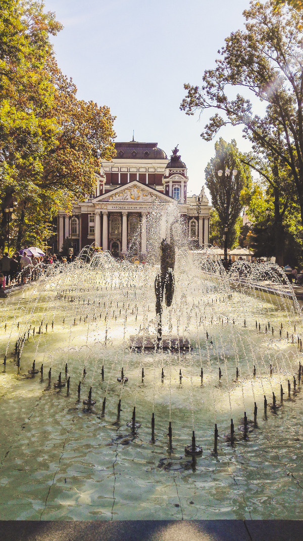 Ivan Vazov National Theatre and the City Garden with the Fountain in front of it in Sofia. Discover the best things to see in Sofia Bulgaria from this insider's guide to Sofia. #sofia #sofiaguide #sofiatravelguide #sofiabulgaria #bulgaria