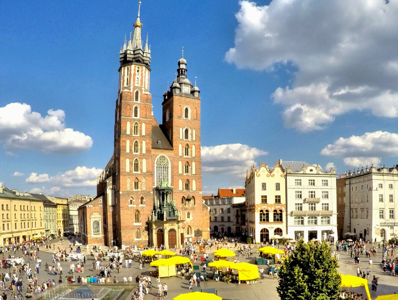 Krakow Rynek, the splendid main square, is one of the places to visit in Krakow. Use this insider's Krakow guide to discover the top Krakow tourist attractions and to plan your Krakow itinerary. Useful travel tips for Krakow are included as well. #krakow #krakowguide #krakowtravelguide #krakowcityguide #krakowtips #krakowpoland #poland #krakowattractions