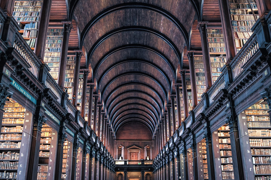 The Trinity College Library in Dublin is one of top 10 must visit attractions in Europe. Discover them all in the article. #europe #europeattractions #europeplacestovisit