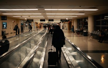 people at an airport. Discover what to pack for a trip to Europe in spring from this article.