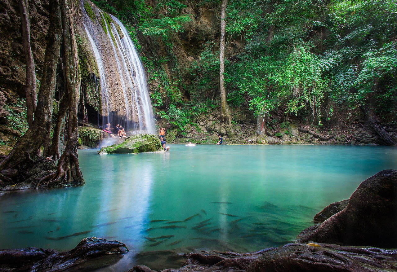 Erawan Waterfalls, Thailand. Discover the best Thailand attractions and off the beaten path things to do in Thailand. #thailand #travel #asia