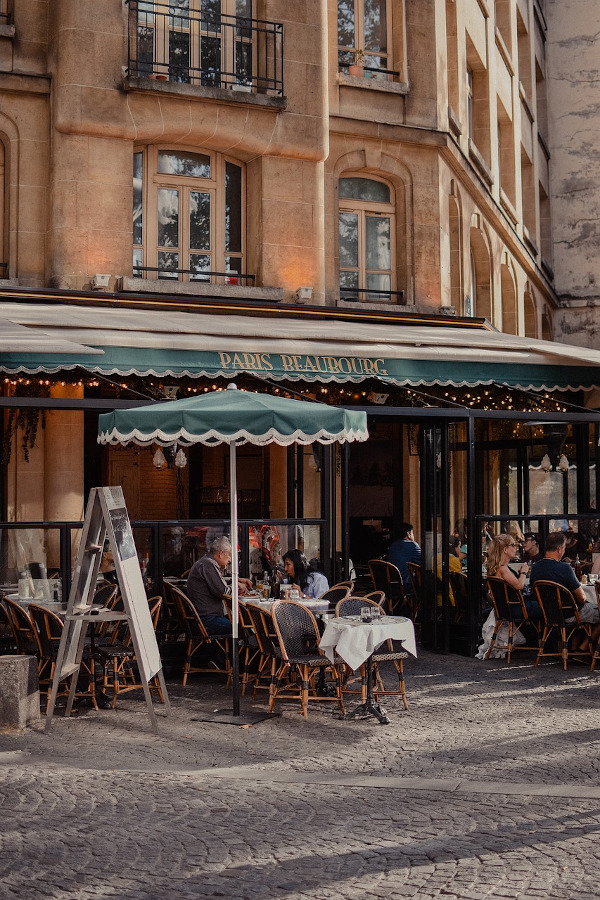 Paris restaurant. 22 things to know before your first trip to Paris - including Paris tipping, best time to visit Paris, where to stay in Paris for the first time, Paris public transport, and more