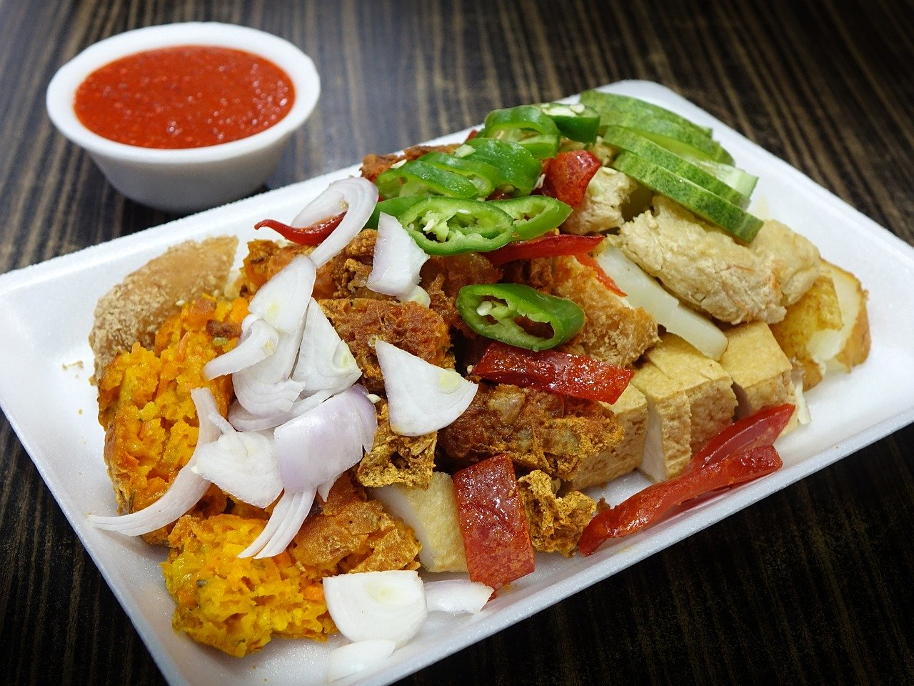 Wondering what to eat in Singapore? Indian Rojak is one of the best Singaporean dishes to try. Discover more in this article - read it now!