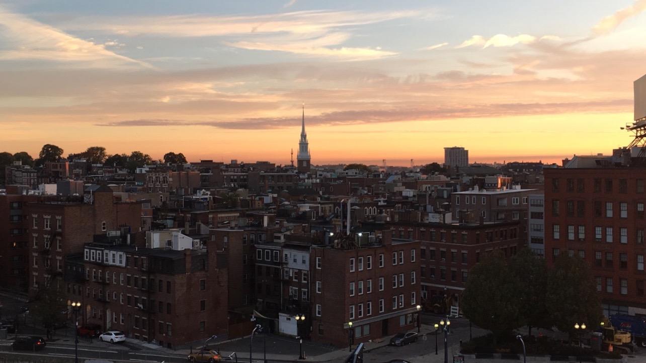 Boston Downtown sunset. Read this article and go Boston sightseein. Create your Boston bucket list